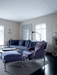 cooler purple shades in sandy gray room. Lovely.