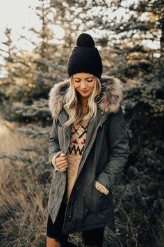 """Olive Hooded Winter Coat Detachable Faux Fur Hood Lining Zippered Front + Snap Buttons Sherpa Lined Torso + Hood Layered Front Pockets Drawstring in Hood Fishtail Hemline View Size Chart Model is 5'9"""" + Wearing a Small"""