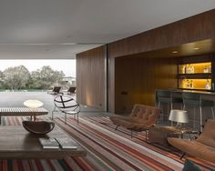 Single story residence. Wood wall coverings. Recessed bar area.