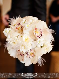 Emerald City Orchids, White flowers & ostrich feathers. Fresh Design, photo by: Front Room Photography