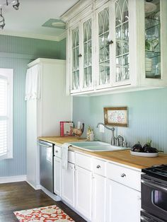 this is what we're doing in the kitchen - white cabinets, butcher block countertop, pale blue walls