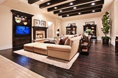 Wow! Love this living room neutral color scheme!! Love the dark colored ceiling beams