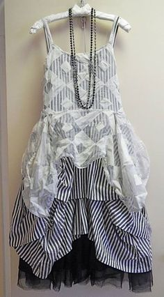 From @KatiKoos, a black cotton/silk satin Underpinning Skirt brings up the bottom under an ivory/black striped cotton broadcloth Umbrella Slip and a graphic square silk organza Pinwheel Cami all from Krista Larson.