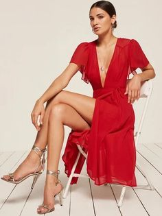 For that thing you have to go to. This is a midi length, wrap dress with a low v neckline and high slit.