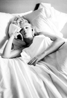 Photographed by Milton Greene, 1953. | iconic image | marilyn monroe in bed | sleepy | sexy | relaxed | white | beauty | hollywood starlet | icon | between the sheets