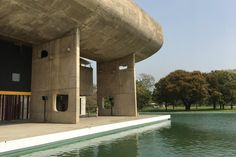 Chandigarh's Palace of Assembly mixes Brutalist and Mid-Century touches for a structure that feels slightly Soviet, but in an artful way. The massive cement roof swoops up from the building, reflected in the pool below.