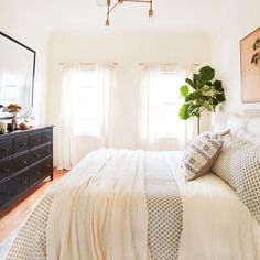 Discover these seven DIY upgrades you can make to your bedroom. One change you can make is adding more natural light, an easy fix helped by adding cream-colored curtains that flow all the way down to the floor in a glamorous, devil-may-care look. | Pulte Homes