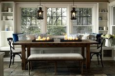 dining space with rustic table, built in window seat, and nice storage shelves. ml interiors Window seat and windows Decor, Dining Nook, House, Interior, Home, Dining Room Lighting, House Interior, Home Kitchens, Interior Design