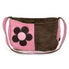 The Snuggle Sack was created exclusively with comfort in mind for you and your tiny travel companion. Designed to wear across the chest, this messenger style carrier allows for hands free shopping, running errands or whatever activity you want to do with your pet while he or she snuggles right at your side in the lap of luxury. Made of durable chocolate ultrasuede, our Snuggle Sack features a sparkly crystal button, wide straps for carrying comfort, 2 usable side pockets, interior safety…