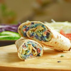 """Cabbage (Dyed) Omelette Wrap- An exciting twist on popular Ugandan street food...the """"Egg Rolex""""."""