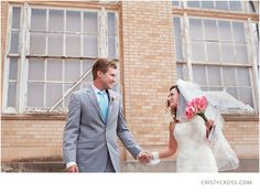 Light blue/aqua tie paired with the brides pink roses.