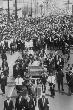 Martin Luther King Jr. Photo Gallery: Martin Luther King Jr.'s casket being carried through streets on a mule-drawn wagon in Atlanta, April 9th, 1968.