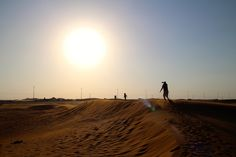 """Playing """"chasey"""" in the dunes around Dubai. For more fun ideas for things to do in the big shiny city, see our insider interview here: http://www.suitcasesandstrollers.com/interviews/view/dubai-with-kids-dubai-insider?l=all #GoogleUs #suitcasesandstrollers #travel #travelwithkids #familytravel #familyholidays #familyvacations #traveltips #Dubai"""