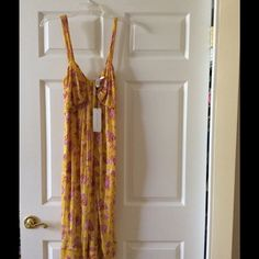 Brand new DVF style Sylvie size 10. Citron yellow with lilac and flame design. Lovely fabric. Three layers of chiffon. Very light and perfect for taking on vacation as it does not crease. Perfect for day or evening wear. I have several which I wear with my Christian LaCroix sandals shown, but this color was the wrong choice for me personally so it is time to take it out of my closet and sell! Original label from Neiman Marcus is on the dress. Diane von Furstenberg Dresses