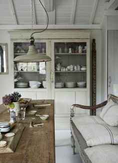 Charming French farmhouse kitchen eating area with farm table, antique hutch, farmhouse bench, and industrial light. French Farmhouse Decor Inspiration Ideas will take you on a romantic tour of images capturing this charming decor style. Decor, House Design, House, Interior, House Styles, Home Decor, House Interior, Interior Design, Rustic Dining Room