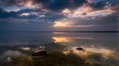 Lake by AndrzejAntczak lake sunset water stones clouds Poland Lake AndrzejAntczak Photos Of The Week, Landscape Photography, Travel Photography, Poland, Tourism, Places To Visit, Clouds, Vacation, Sunset