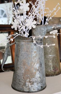 Oil Can Decor - Get those pretty beauties out of the garage!  Shared at Knick of Time Tuesday - http://knickoftimeinteriors.blogspot.com/2013/01/knick-of-time-tuesday-70_21.html