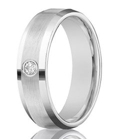 A single bezel set diamond is the perfect eye-catching accent to this designer 14K white gold wedding ring for men. $569.95