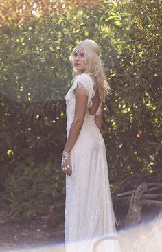Like the sleeves and back esp.  Ethereal bohemian wedding dress by Daughters Of Simone.