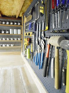 Super organized garage storage space (I'm in love with the paint storage & pegboard... but thou shall not covet thy neighbor's garage storage... right?)