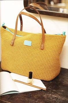 Modern Crochet tote bag. Beautiful modern mustard yellow color and leather handles.