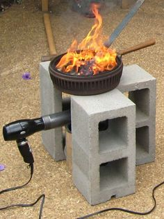 """My son caught the blacksmithing bug while he was at summer camp so we investigated building our own blacksmith forge and found that brake drum forges are a very popular way to get into the hobby. We built our blacksmith forge out of a brake drum, 2"""" pipe, cinder blocks, a light dimmer switch and hair dryer. Here is a video with all of the same pictures in this instructable plus a short video at the end of the forge in action. Brake Drum Forge, Blacksmith Forge, Iron Work, Metal Working, Build A Forge, Homemade Forge, Black Smith, Metal Projects, Metal Crafts"""
