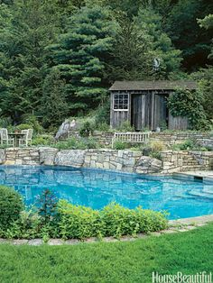 Rock Wall: Boulders at the edge of the swimming pool are typical of the way this designer has designed around the ledge.