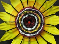 Instructions with photos for plate weaving: Time for Art!: WEAVING PAPER PLATES--this style and color could be for sunflower/st. Weaving For Kids, Weaving Art, Classe D'art, 4th Grade Art, Third Grade, School Art Projects, Weaving Projects, Craft Projects, Spring Art