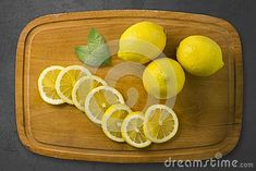 Photo about Zesty lemons design on a chopping board with lemon leafs. Vitamins, Lemon, Stock Photos, Orange, Fruit, Board, Design, The Fruit, Vitamin D