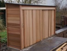 Want to find out about how to build a sheds? Then this is definitely the right place! Pool Shed, Backyard Sheds, Outdoor Sheds, Outdoor Spaces, Bike Storage Design, Shed Storage, Cedar Garage Door, Garage Velo, Garbage Shed