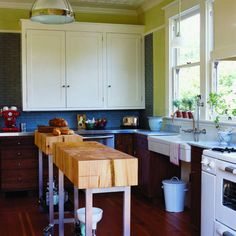 Revitalized Craftsman An unlikely blend of materials and salvaged goods finds visual balance in this kitchen. A painted tin ceiling, stainless steel counters, and blue glass tile mesh seamlessly. See more of this creative Craftsman  Read more: How to design a vintage-modern kitchen  Photo: Lisa Romerein, Sunset.com