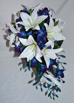 Silk Blue Dendrobium Orchids.  I love the lilies with these orchids, but I may do a different flower with similar petals.