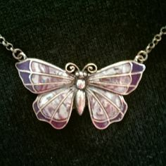 Butterfly necklace Beautiful butterfly necklace.  Antique gold colored chain and body of butterfly.  Tips of wings are a dark purple, and the rest of the wings are kind of swirls of different shades of purple with a little teal.  It's very pretty! Jewelry Necklaces