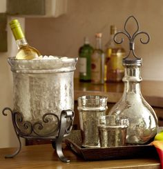 Serve guests in style with distinctive hammered glass bar accessories