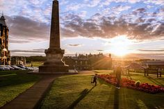 A father and son play near Martyrs Monument in St Andrews. Fuji X100s.
