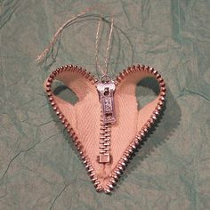 ornament made with a recycled metal zipper. you could probably also make it into a pendant