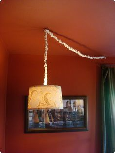 Turn any lampshade into a hanging light...I don't necessarily like the look of this particular one, but the method is great and I will be using it!