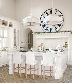 I so don't like oversized clocks but I love the slipcovered barstools
