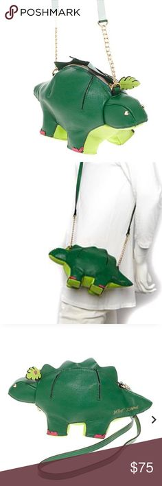 "Betseysaurus Rex Kitsch Dinosaur Green Cross Body Betseysaurus Rex Kitsch Dinosaur Green Cross Body Bag Approx. 13""L x 5""W x 7""H with a 23""L shoulder strap Betsey Johnson 100% Authentic New with tag  Cute Dinosaur shape crossbody bag Stegosaurus shape Clutch handle or crossbody strap Fully lined interior Zipper closure Smoke Free Home Betsey Johnson Bags Crossbody Bags"