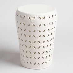 Refresh your outdoor seating arrangement with our drum stool, embellished with a punched pattern around the sides for a global-inspired look. In classic white, it also makes a bold accent table.