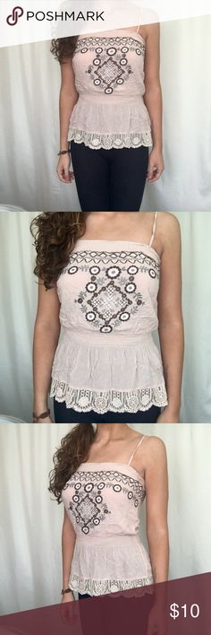 XXI Boho Aztec tank top pink size small XXI Boho light pink tank top with an Aztec gray and brown design throughout. This waist is fitted and the bottom is flowy with a lace lining. It is great quality! - Size small - This item comes from a smoke-free home and doesn't have any blemishes or tears. It is used but is like new!   Measurements laying flat: Pit to pit: 13 inches Length: 18 inches Waist: 10.5 inches XXI Tops Tank Tops