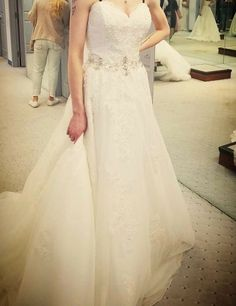 33fa82cc875e New with tags Alfred Angelo style Wedding gown. Ivory with silver beading.