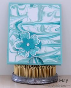 handcrafted card ... monochromatic turquoise ...luv how she used the Shaving Cream Marbling technique exactly matchin the colors of the layered flower ...