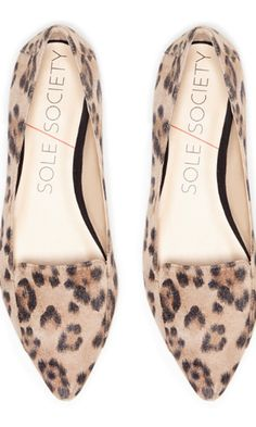 Leopard flat with a pointed toe and loafer-like detail.
