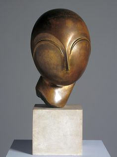 Artwork page for 'Danaïde', Constantin Brancusi, c.1918 This is a stylised portrait of Margit Pogany, a Hungarian art student Brancusi met in Paris in 1910. He made a marble head of her from memory, then invited her to his studio. He was delighted when she recognised it. This is one of several bronzes based on the marble. Photographs show that Miss Pogany had a round face with large eyes and strong eyebrows, and wore her hair in a smooth chignon. Brancusi has refined her features down to the…