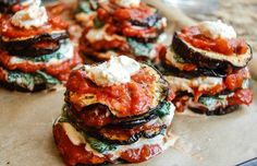 A twist on a classic Italian meal features baked eggplant slices stacked with cashew ricotta, balsamic infused baby spinach and a sweet red pepper sauce.