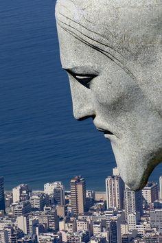 """Rio de Janiero, Brazil. With the profile of Christ the Redeemer (""""Cristo Redentor"""") atop Corcovado mountain."""