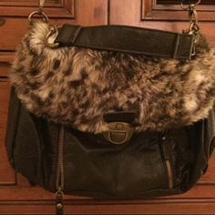 """‼️HP‼️ faux leather, faux fur cross body purse👜 Super-funky faux leather and faux fur cross-body purse. Perfect for Fall and Winter. Superb condition. Zippers on front and sides. Super-cute winter cross body! Width: 13"""", height: 9.5"""", strap drop: 20"""". 💗👭👜👭💗 Gal Bags Crossbody Bags"""