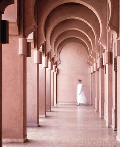 Aman Jenna Morocco arched corridor. | The Decorating Diva, LLC