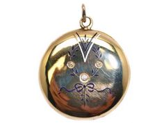18 carat gold locket with diamonds (0.10' ct) and enamel details.